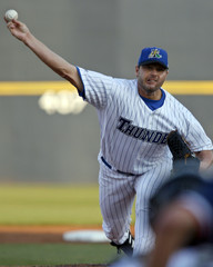 Trenton Thunder pitcher Clemens delivers a pitch to the Portland Sea Dogs during first inning Eastern minor league baseball action in Trenton, New Jersey