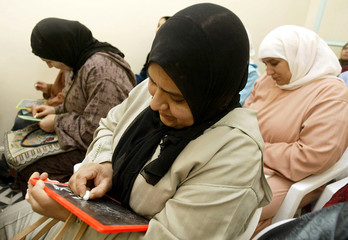 Moroccan women attend a reading and writing class at a literacy school run by an Islamic association..