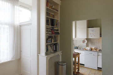 detail of an apartment with kitchen and book case