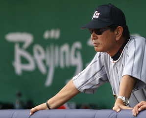 Japan manager Senichi Hoshino watches his team in the seventh inning against the U.S. during the men's bronze medal baseball game at the Beijing 2008 Olympic Games