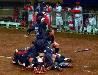 USA CELEBRATE WIN OVER JAPAN AT OLYMPIC SOFTBALL FINAL.