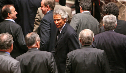 French PM Villepin leaves National Assembly following questions during government session in Paris