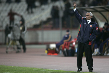 Georgia's coach Cuper gestures during his team's international friendly soccer match against Romania in Bucharest
