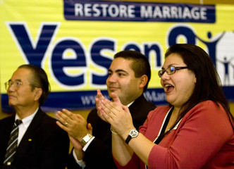 Supporters clap as polls show a lead at a yes on Proposition 8 party in Irvine, Califiornia