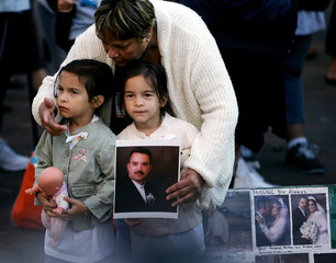A family holds up a photo of a September 11, 2001 victim at the World Trade Center in New York City