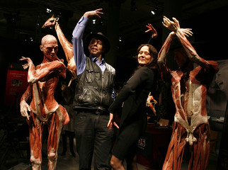 German anatomy professor Gunther von Hagens and his wife, German doctor Angelina Whalley, pose between plastinated human specimens in Seville