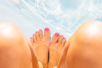 Crop shot of feet in pool