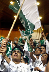 Pakistani students wave national flags during ceremony marking nation's 58th Independence Day in ...
