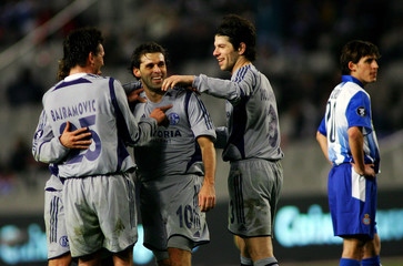 Schalke 04's Lincoln celebrates with his team mates after scoring third goal against Espanyol in Barcelona