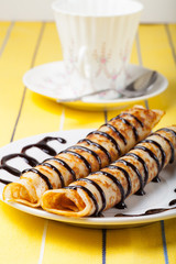 Russian pancakes - blini with chocolate topping. Selective focus
