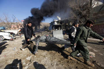 Body of a blast victim is carried away from the site in Kabul