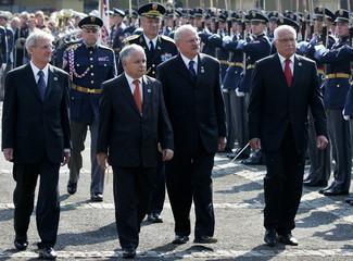 Czech Republic's President Klaus, Slovakia's President Gasparovic, Poland's President Kaczynski and Hungary's President Solyom walk past guard of honour in Slany