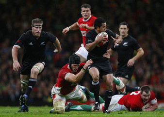 Wales' Charteris tackles New Zealand's Muliaina during their international Rugby Union match at the Millennium stadium in Cardiff