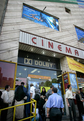 PEOPLE STAND IN LINE TO BUY TICKETS SCREENING AN IRANIAN FILM BY TABRIZI IN FRONT OF A CINEMA IN TEHRAN.