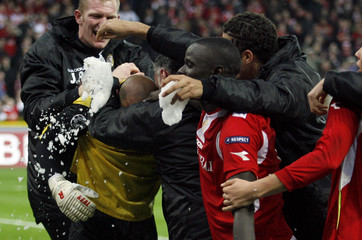 Standard Liege's goalkeeper Bolat celebrates with team mates after scoring during their Champions League soccer match in Liege