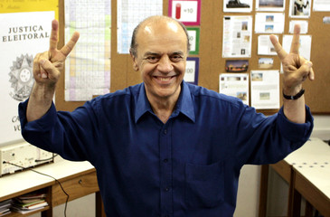 Sao Paulo mayoral candidate Serra gestures after voting.
