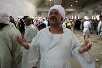 A Muslim pilgrim says a prayer after performing the casting of seven stones at pillars ...