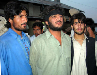 PAKISTANI TRIBESMEN STAND BEFOR BEING RELEASED BY PAKISTAN ARMY IN WANA.