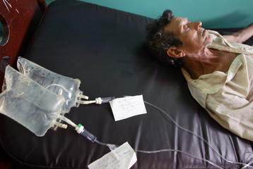 Victim of poisoned liquor rests in his room at hospital in Leon