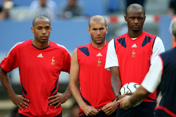 France's  Henry, Zidane and Vieira listen to the coach during World soccer Cup training session in Munich