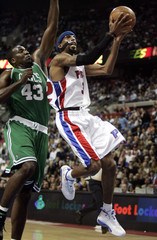 Detroit Pistons guard Hamilton goes to basket in front of Boston Celtics center Perkins in Auburn Hills