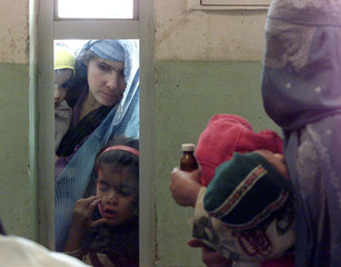 AFGHAN PATIENTS WAIT AT THE CHILDREN'S HOSPITAL IN KABUL.