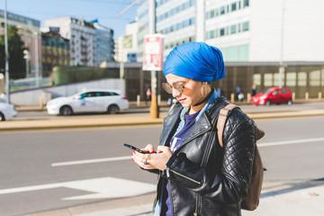 Arabian young woman wearing hijab using smart phone