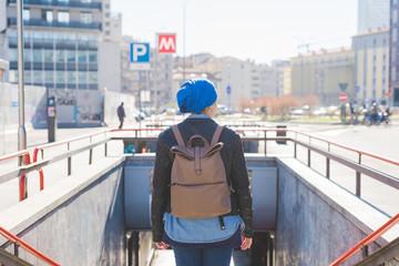 Arabian young woman wearing hijab back view underground
