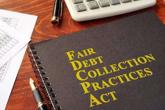FDCPA Fair Debt Collection Practices Act on a table.