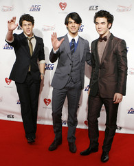 The Jonas Brothers arrive for the 2009 MusiCares Person of the Year gala in honor of Neil Diamond in Los Angeles