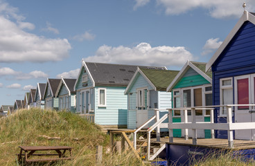 Beach huts in MudEford sandbanks in UK.