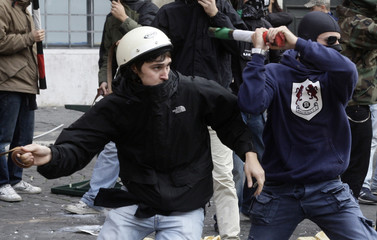 Students from left and right wing blocs clash in Piazza Navona during a protest against a senate vote on educational reforms in Rome