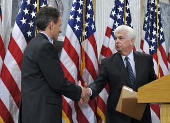 Treasury Secretary Geithner is introduced by Chairman of the Senate Banking Committee, Senator Dodd in the Cash Room of the U.S. Treasury Department in Washington