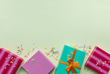 Holidays giftboxes on the pastel yellow background