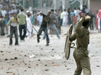 Kashmiri protesters and Indian police throw stones at each other during a protest in Srinagar