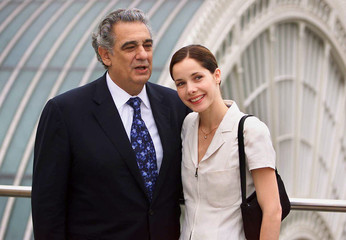 Spanish opera singer Placido Domingo and British ballerina Darcey Bussell pose for pictures on the r..