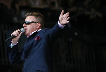 Lead singer of British band Madness Suggs performs at the Glastonbury Festival 2009 in south west England
