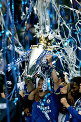 Chelsea's captain John Terry celebrates winning the English Premier League after their soccer match against Manchester United in London