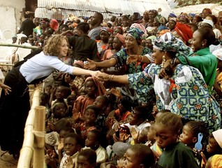 CHELSEA CLINTON SHAKES HANDS WHILE IN VILLAGE OF USHAFA IN NIGERIA.