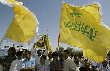 Iraqi Hizbollah party members and supporters demonstrate in Baghdad.