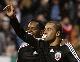 D.C. United's Fred puts a pacifier in his mouth as he celebrates his goal with teammate Luciano Emilio against Harbour View FC during the second half of the second-leg of the CONCACAF Champions' Cup quarterfinal match at RFK Stadium in Washington