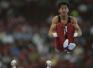 Alsadi of Qatar performs on the parallel bars during the World Artistic Gymnastics Championships in Stuttgart