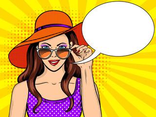 Woman looks through sunglasses pop art vector