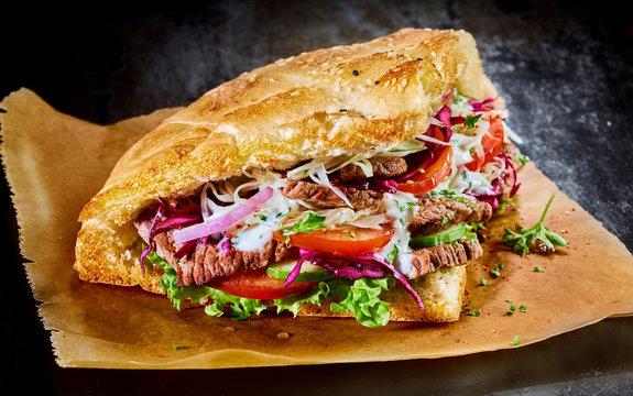 Turkish doner kebab on golden toasted pita bread