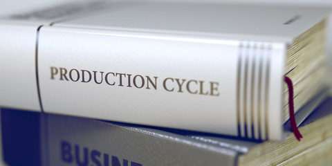Close-up of a Book with the Title on Spine Production Cycle. Stack of Business Books. Book Spines with Title - Production Cycle. Closeup View. Toned Image. Selective focus. 3D.