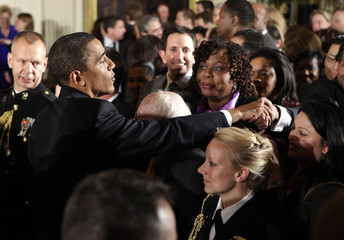 President Barack Obama greets guests at a reception at the White House