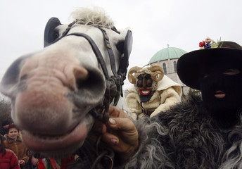 Hungarians and ethnic Croatian Sokac people wearing masks march during the traditional Buso carnival in Mohacs