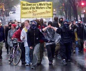Demonstrators march in the streets of Washington during a protest against the International Monetary..