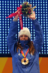 Laoura of France celebrates after receiving bronze medal for women's moguls freestyle event at the Winter Olympic Games