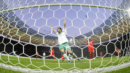 Hugo Almeida of Werder Bremen celebrates the decisive goal of the German soccer cup (DFB-Pokal) final against Bayer Leverkusen in Berlin